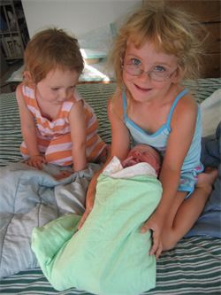 siblings with newborn baby homebirth midwife Santa Cruz