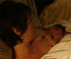 homebirth mother with newborn midwife in Santa Cruz