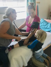 Toddler helping at a prenatal visit