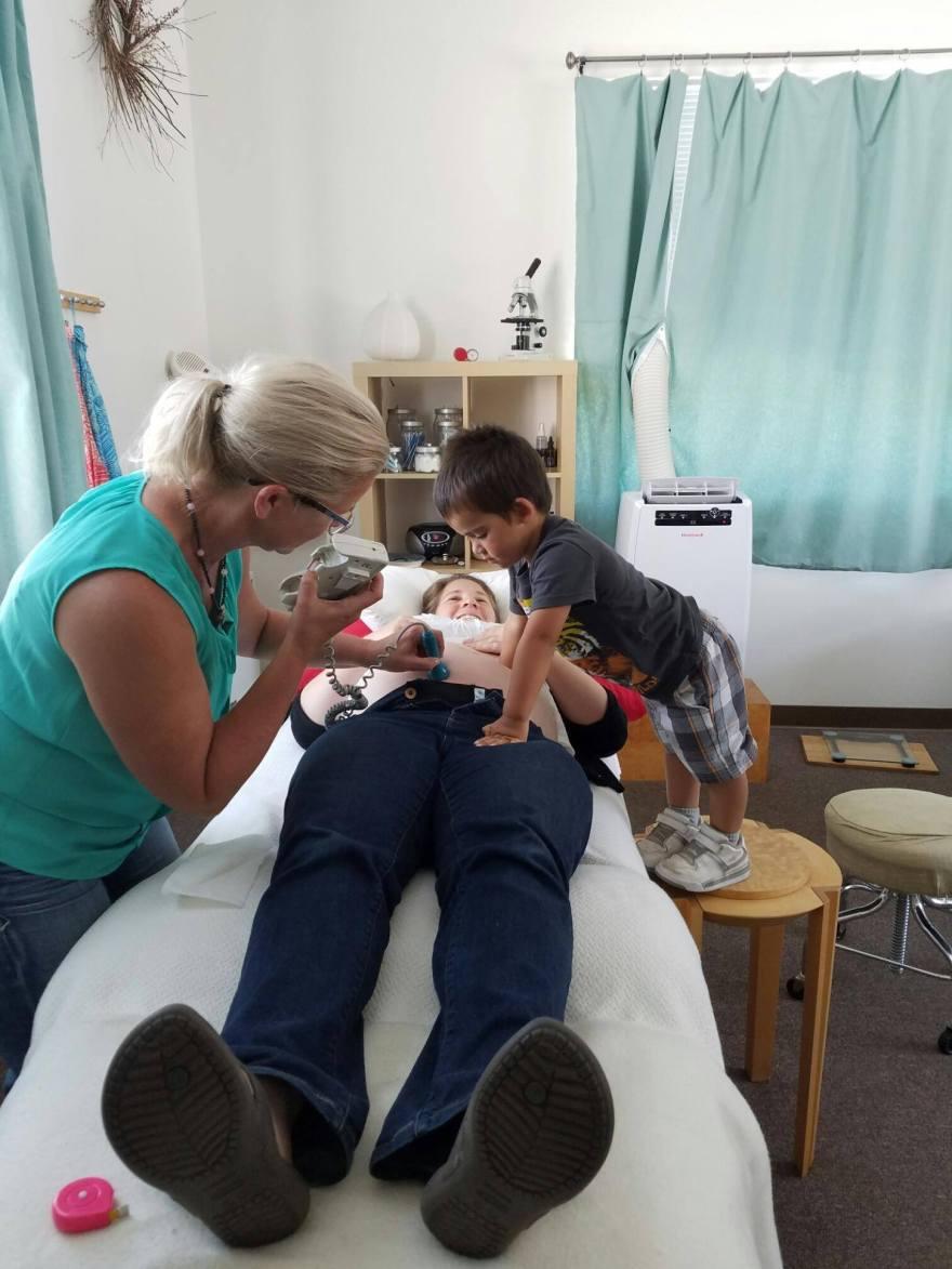 toddler helping at a prenatal visit